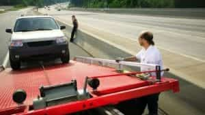 Small SUV Being Towed Away Stock Photo