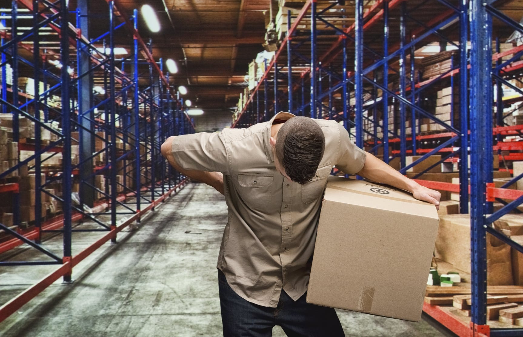 Logistics Worker With Lower Back Injury Stock Photo