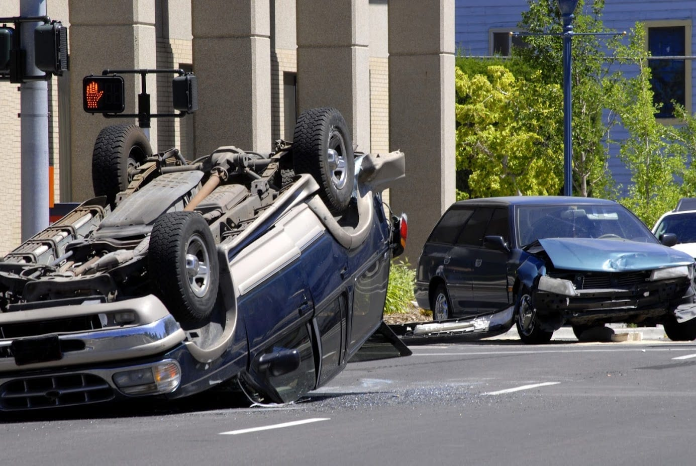 Rollover Car Accident On A Busy City Street Stock Photo