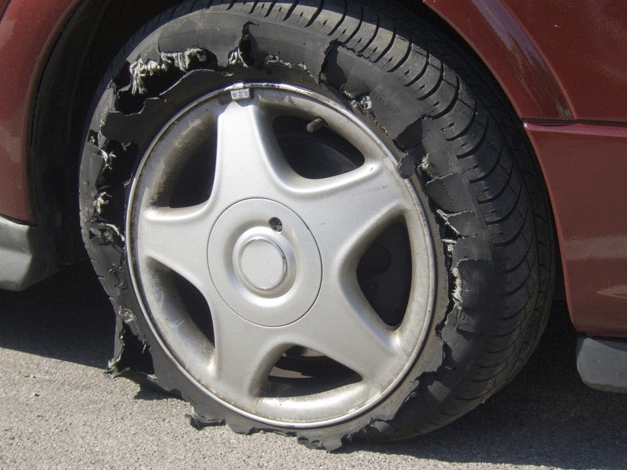 Damaged Car Tire Stock Photo