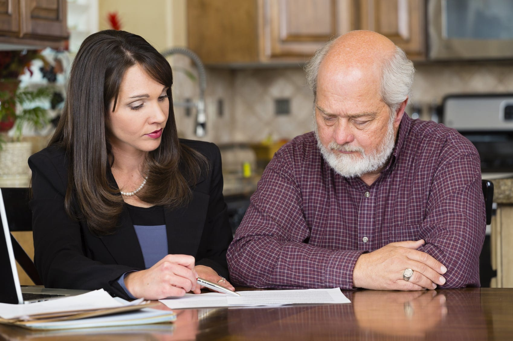 Female Attorney Explaining Legal Documents To Client Stock Photo