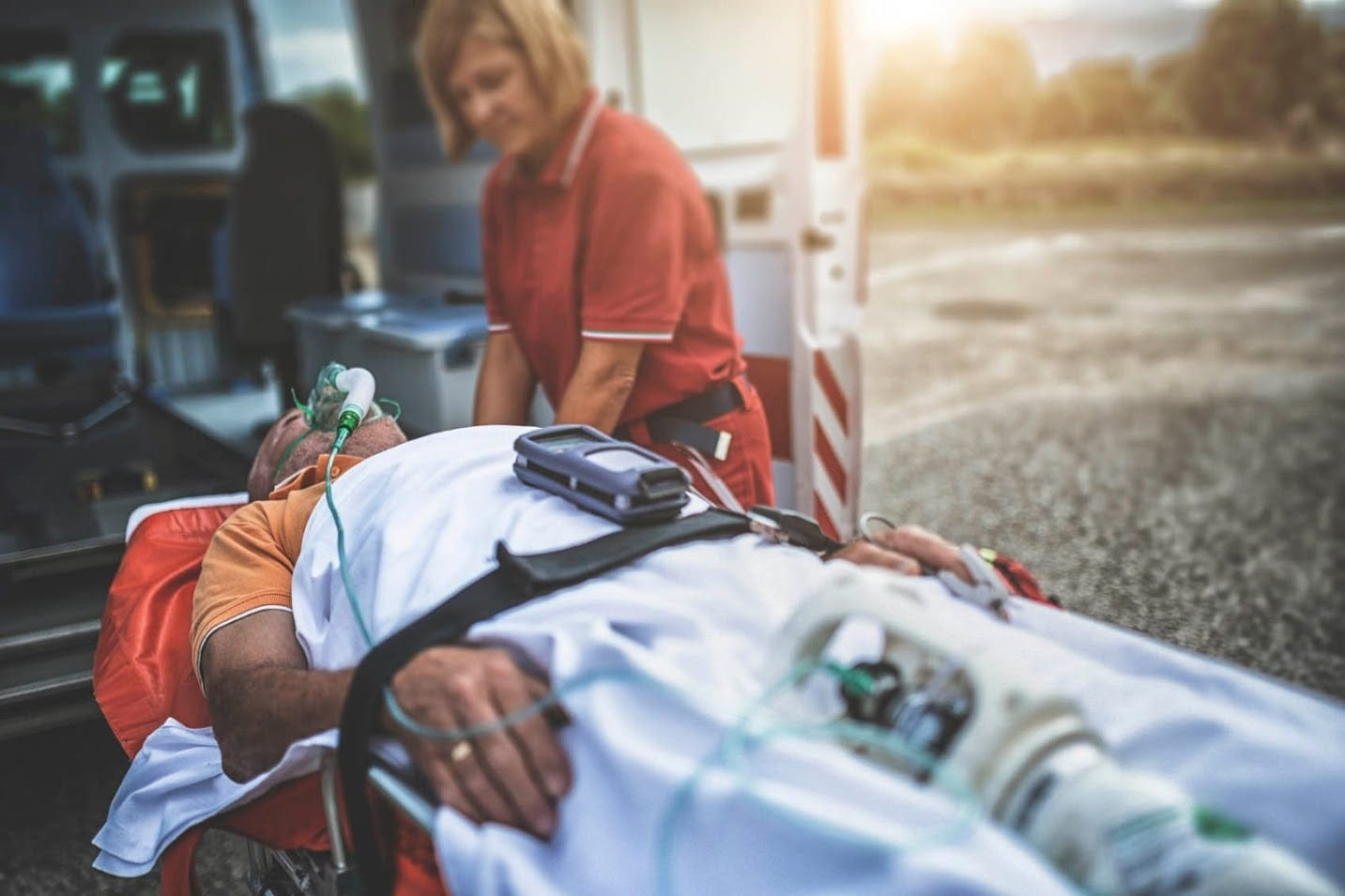 Injured Man Being Loaded Into An Ambulance Stock Photo