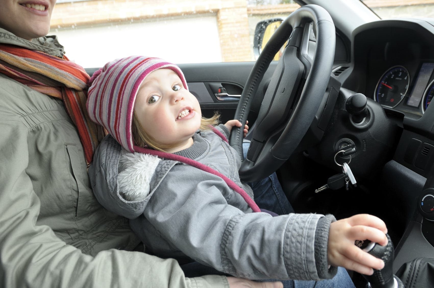 Small Child Riding In Vehicle Without Car Seat Stock Photo