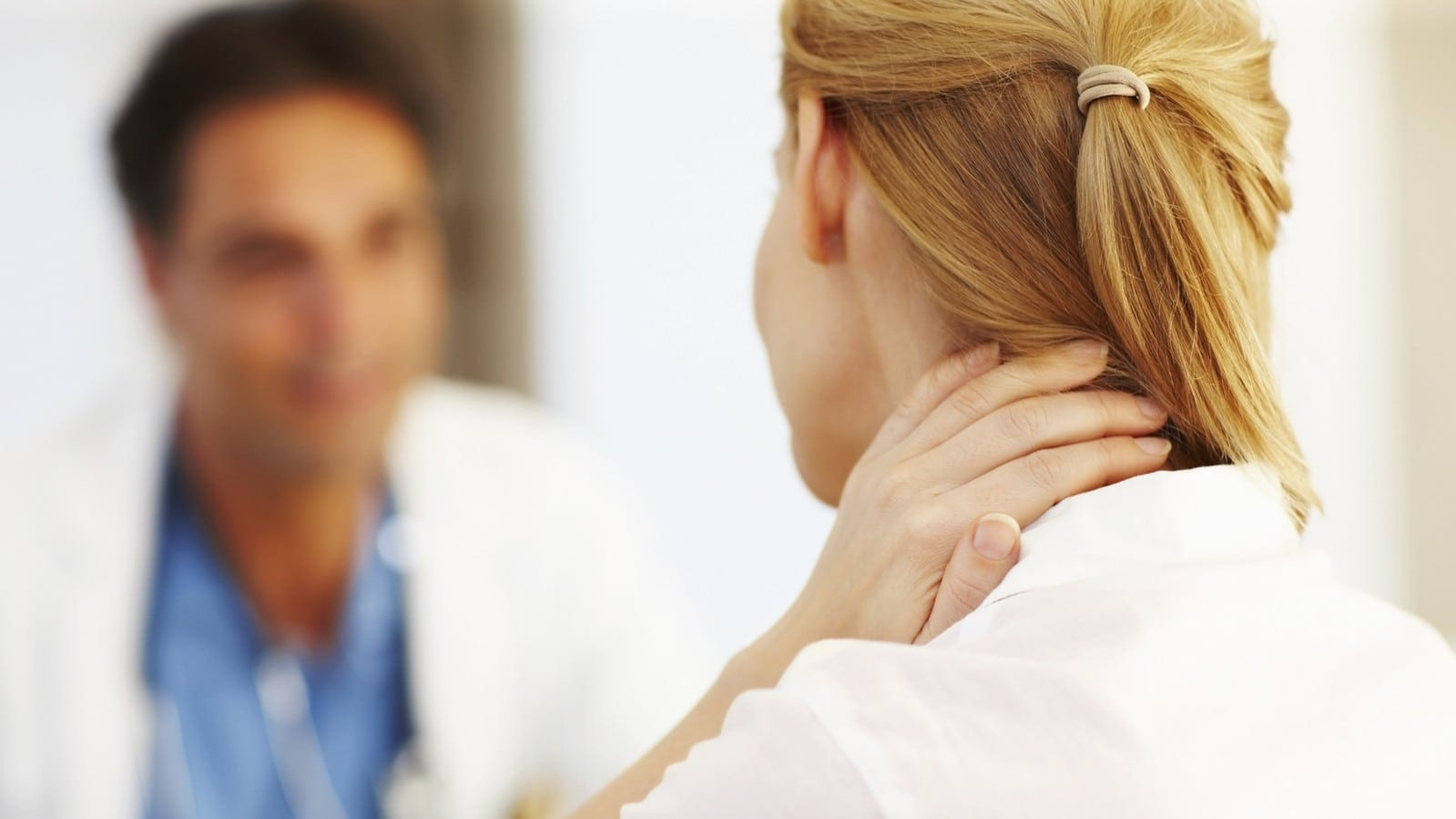 Woman Holding Neck In Pain Stock Photo