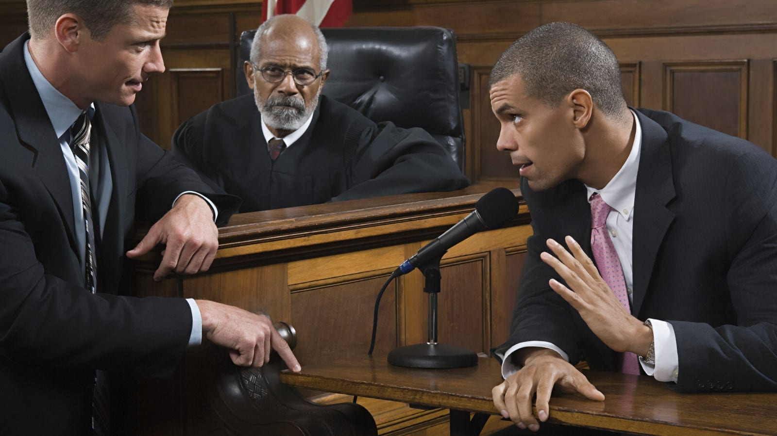Man Being Asked Questions By An Attorney In A Courtroom