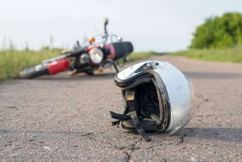 Motorcycle Helmet and Motorcycle Accident Stock Photo