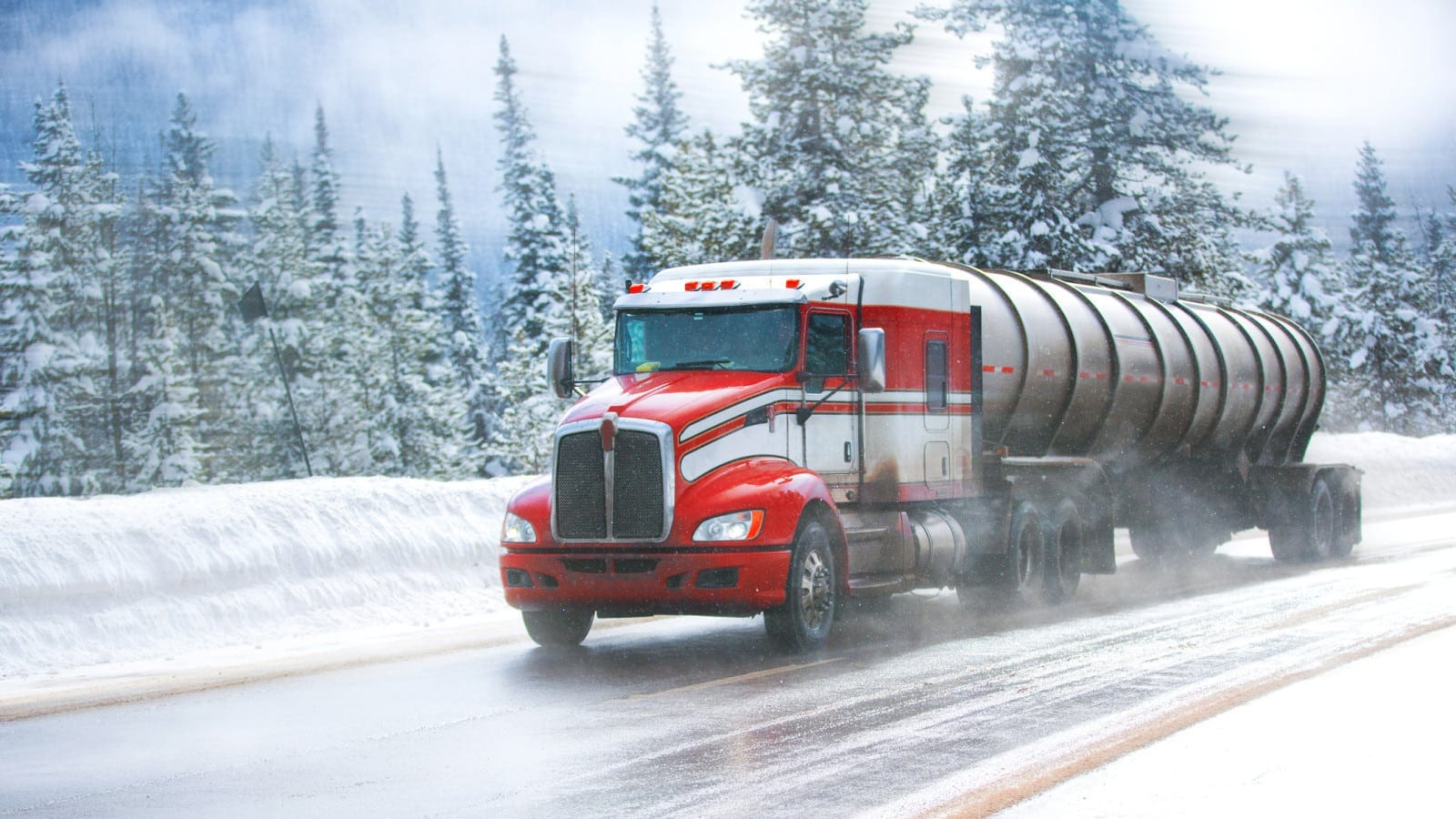 18-wheeler Truck Driving On An Icy Road Stock Photo