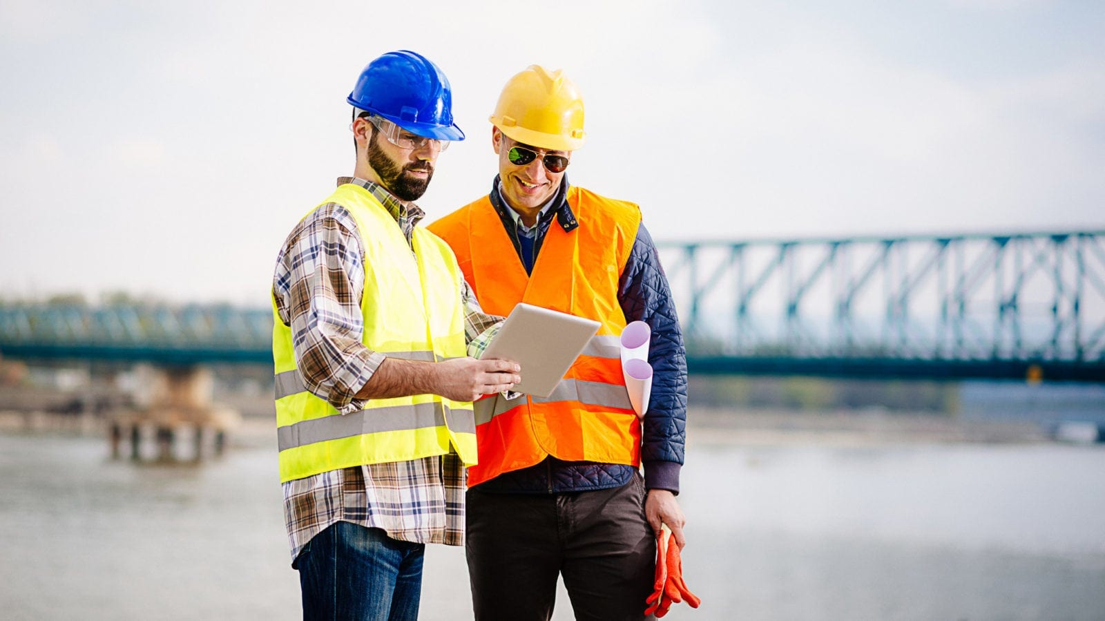 Two Construction Workers Examining A Tablet Stock Photo