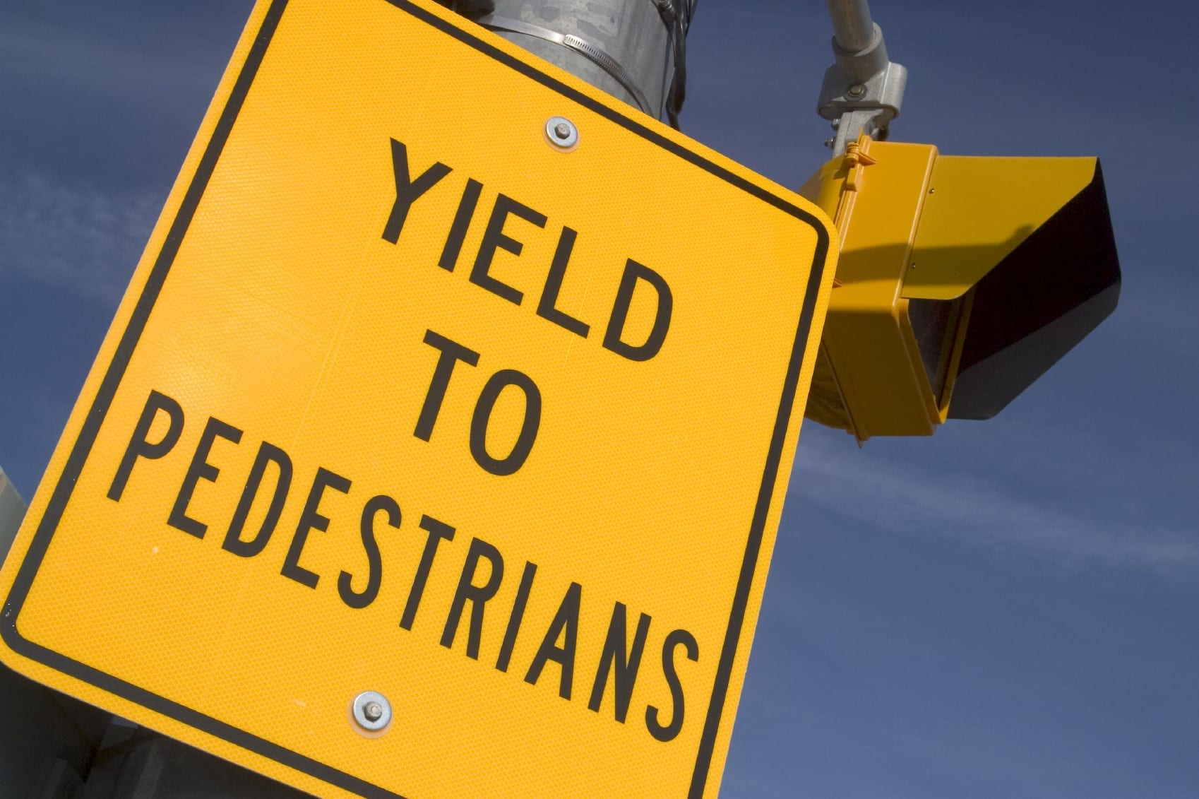 Yield To Pedestrians Sign Stock Photo