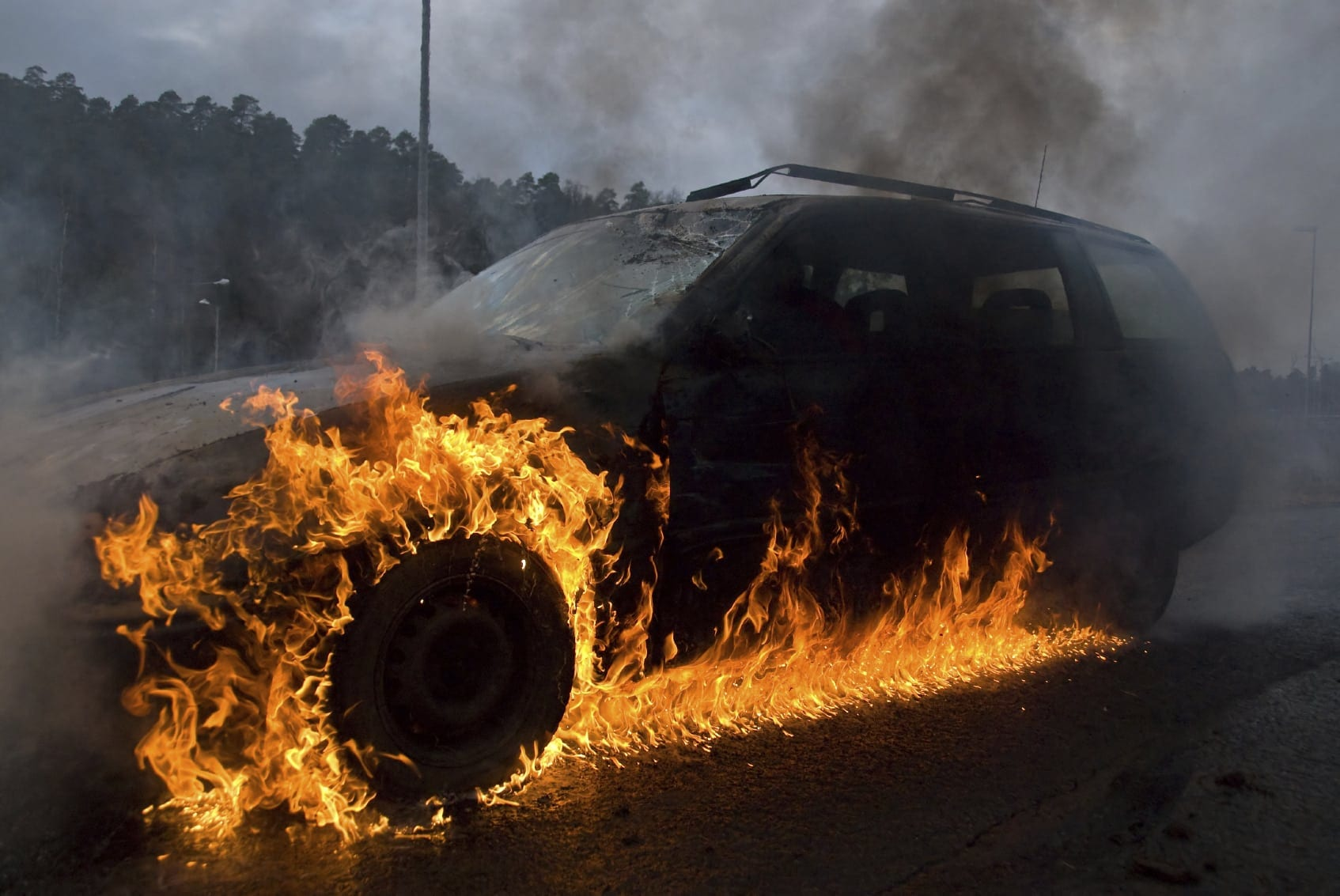 Car On Fire Following Car Accident Stock Photo