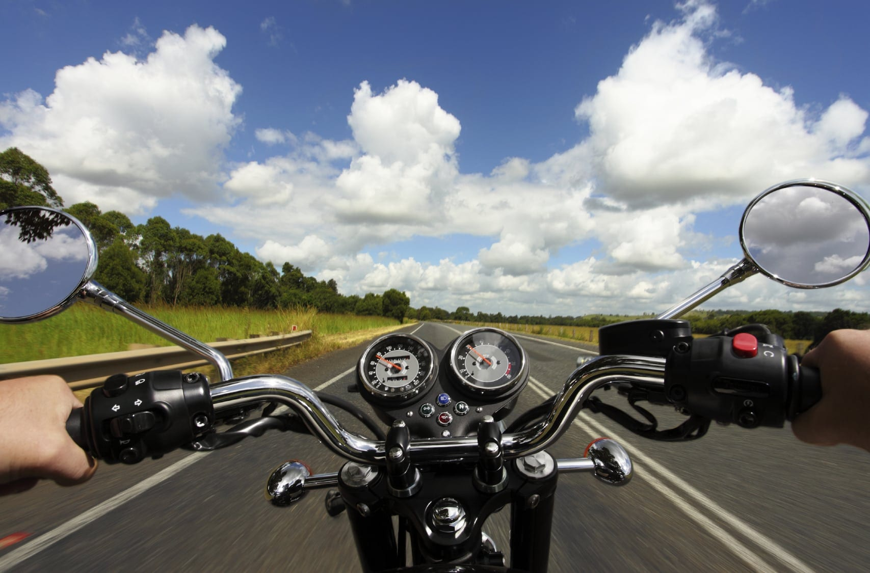 Man Riding A Motorcycle On A Rural Highway During The Summer