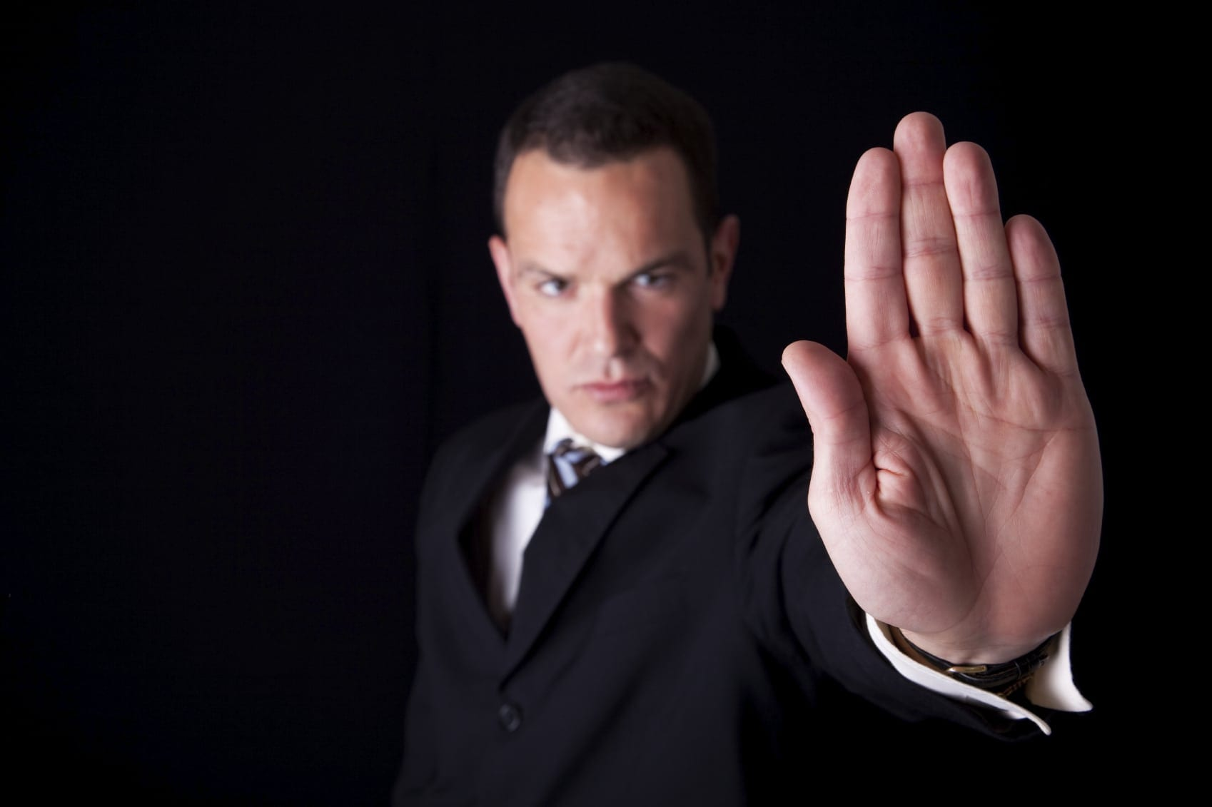 Lawyer Holding Hand Up To Stop Progression