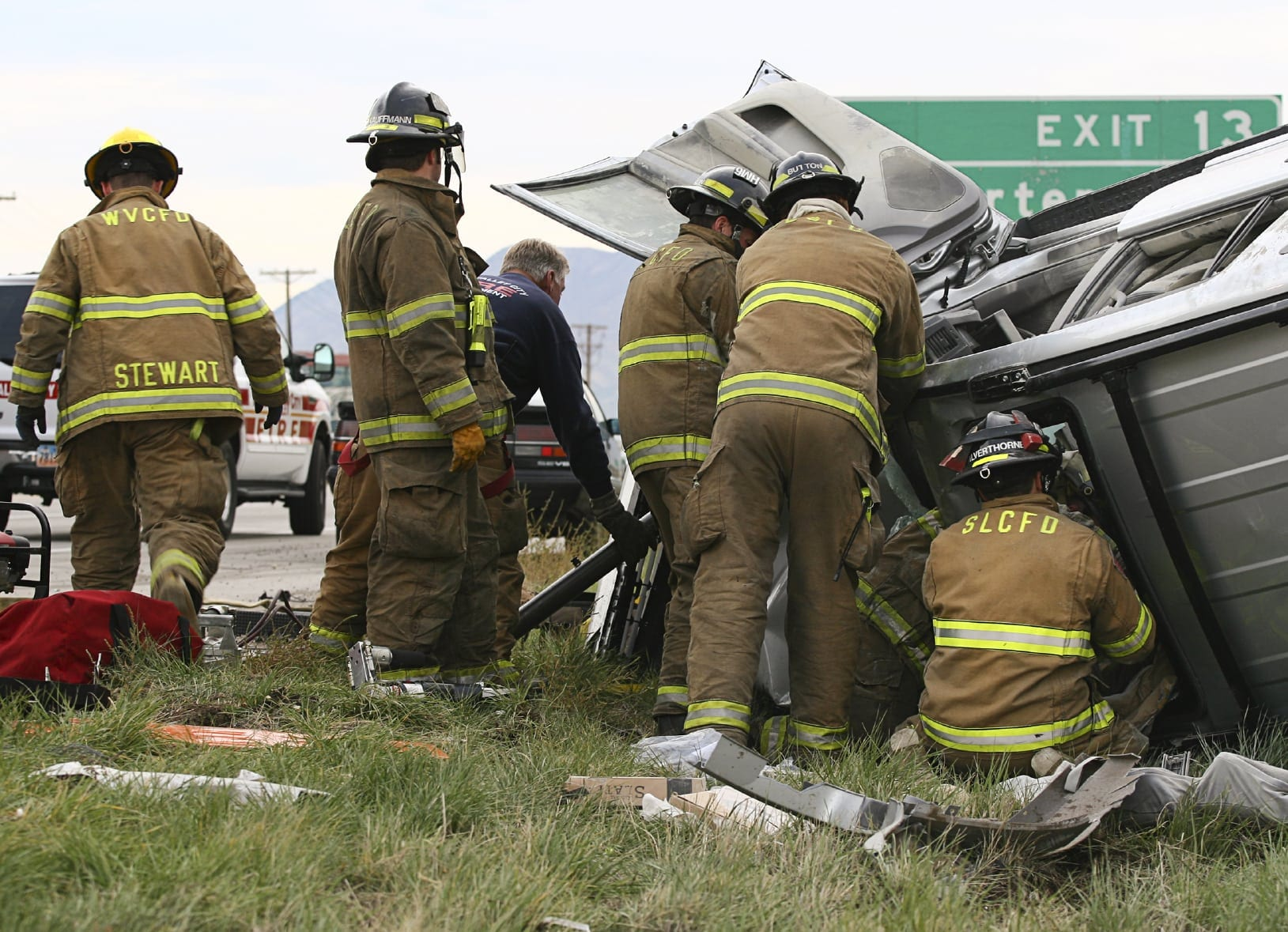 First Responders Responding To A Rollover Car Accident Stock Photo