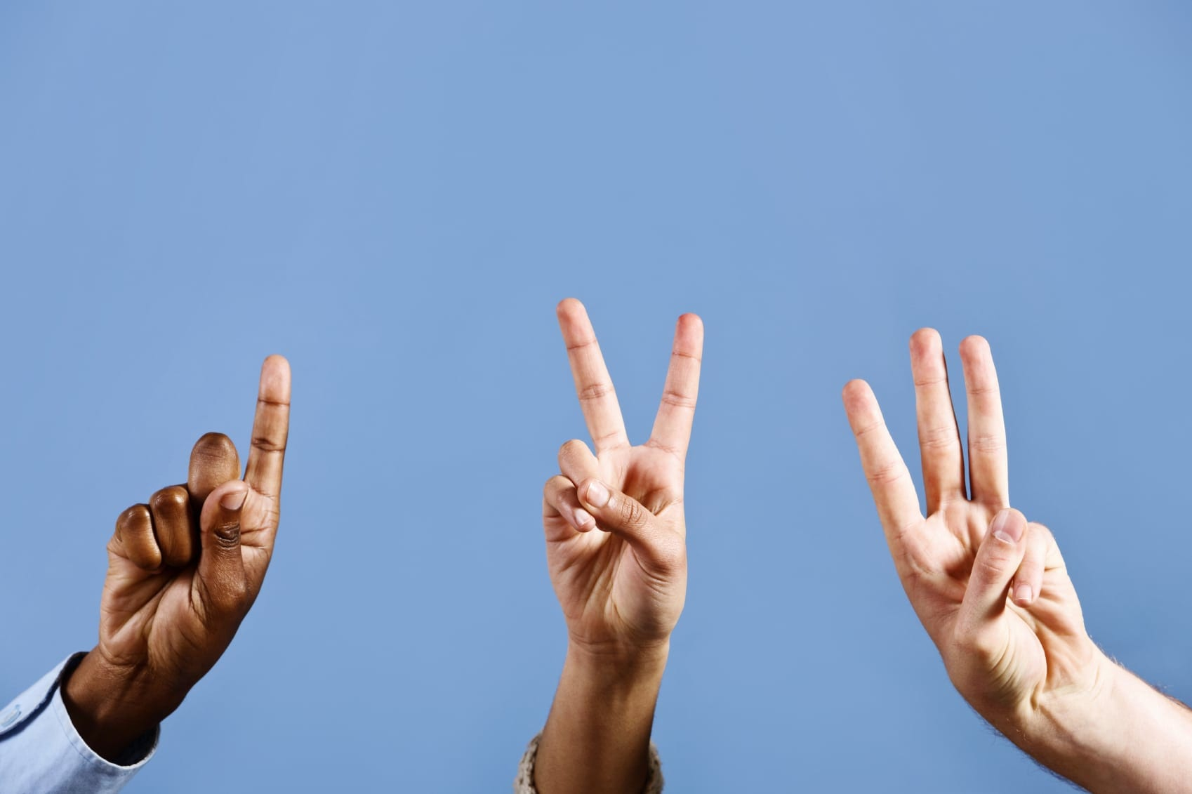 Three Hands Holding Up Fingers Stock Photo