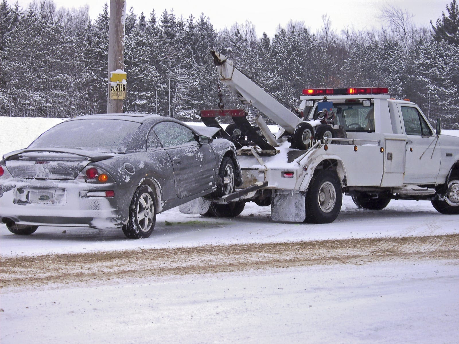 Car Being Towed During The Winter Stock Photo