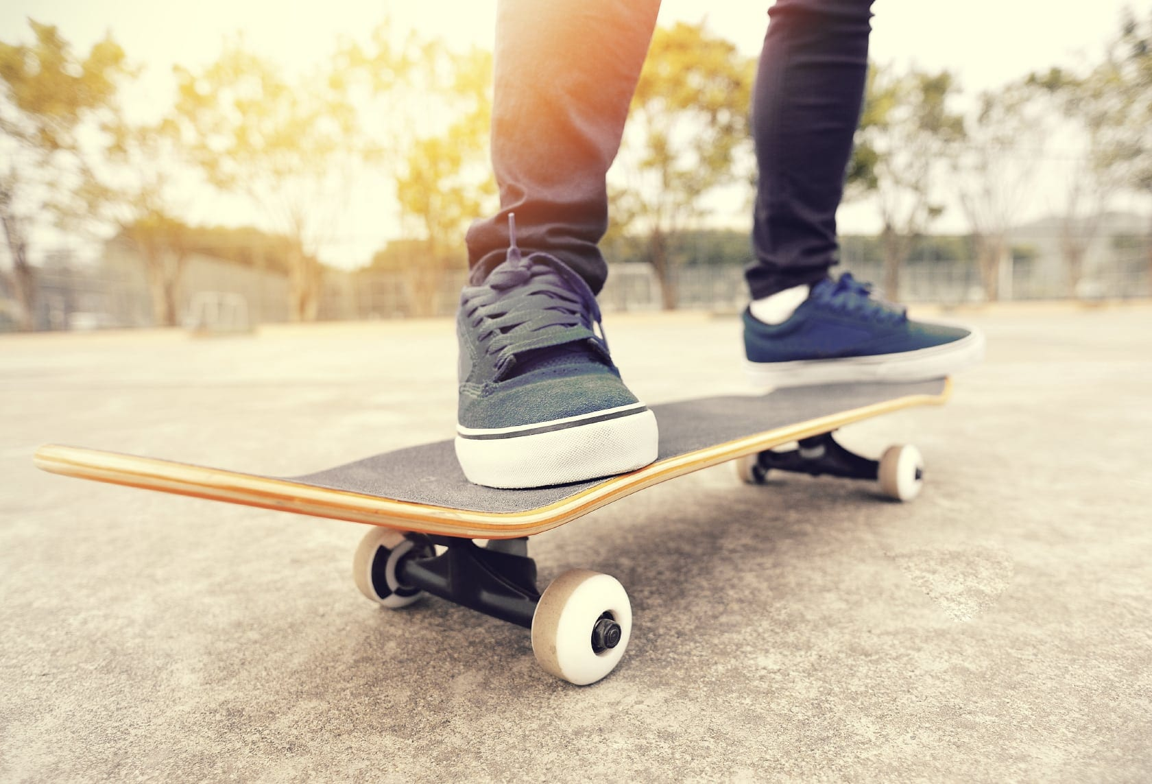 Young Male Teen Riding Skateboard Stock Photo