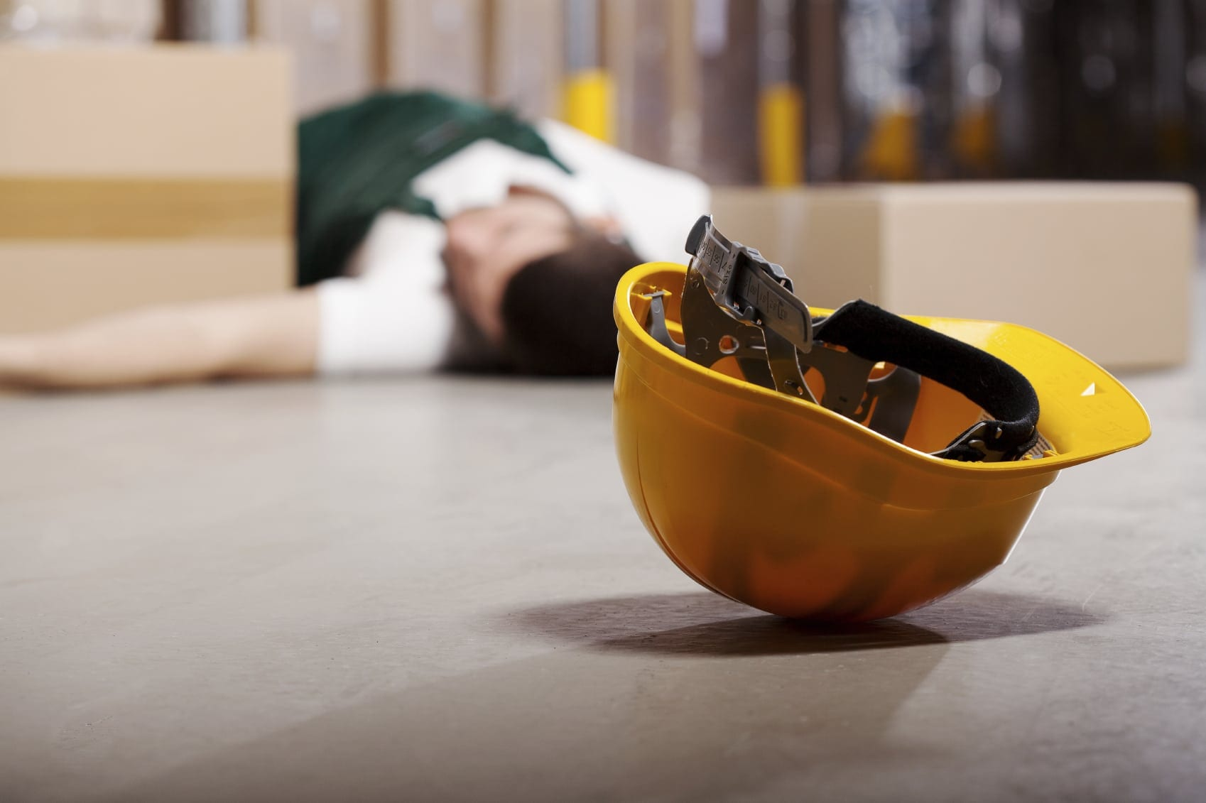 Injured Construction Worker In Yellow Hard Hat Stock Photo