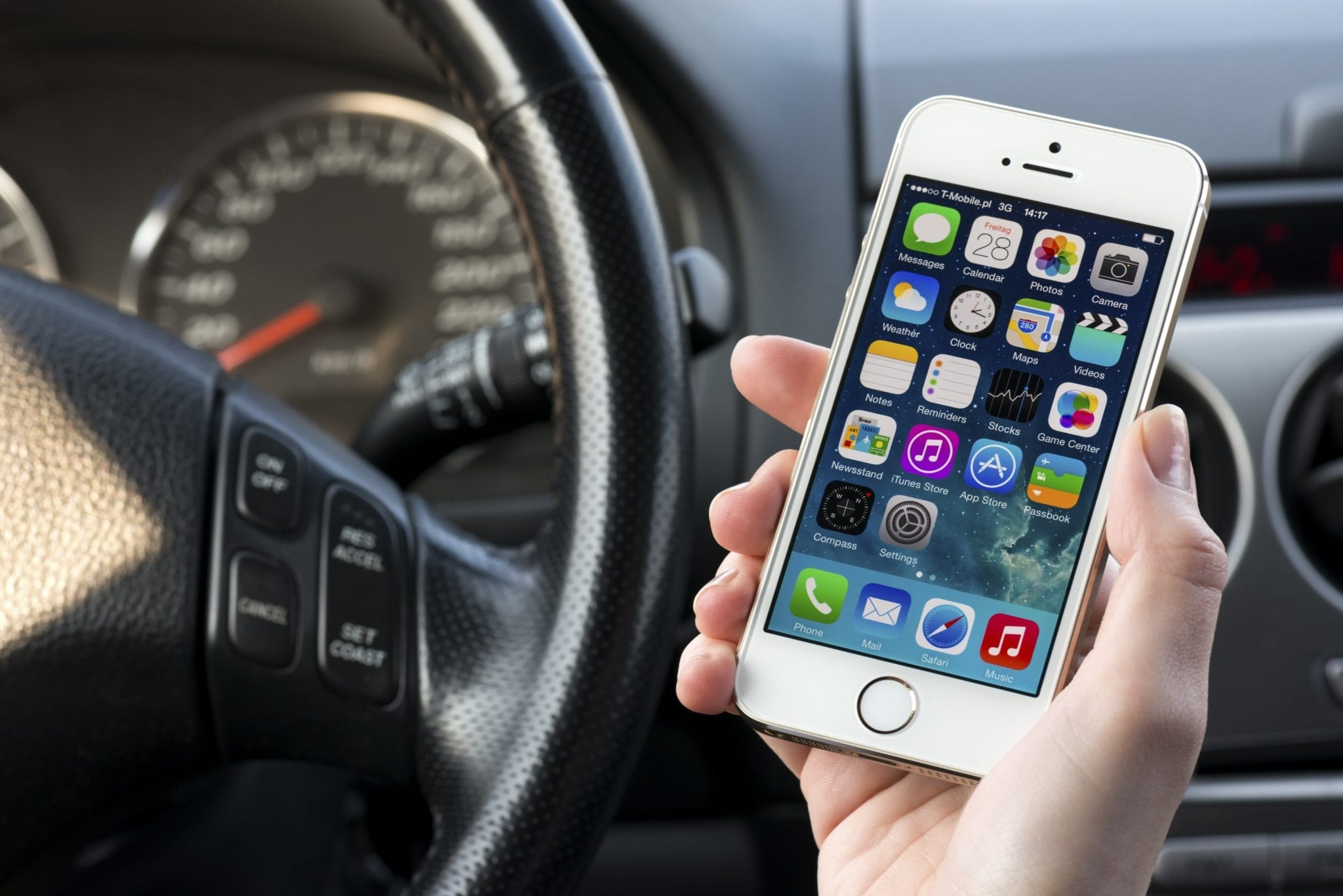 Woman Using Mobile Phone While Driving Stock Photo