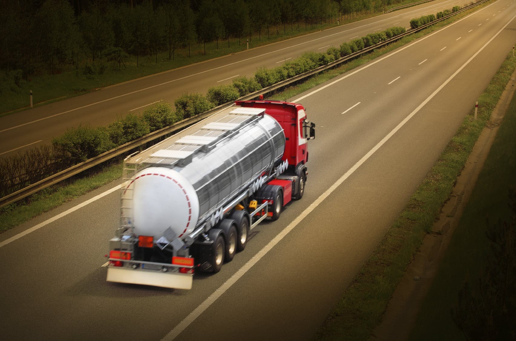 Large Tractor Trailer Driving On A Rural Highway Stock Photo
