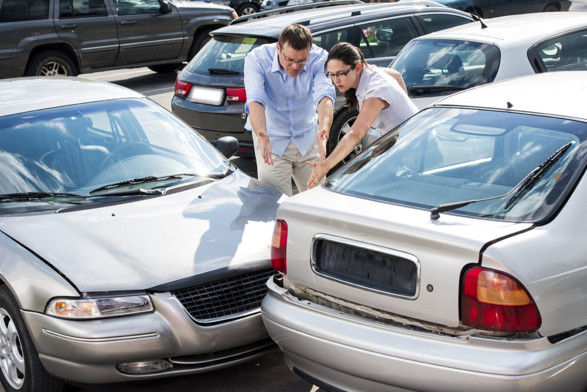 Man And Woman Arguing After Car Accident Stock Photo