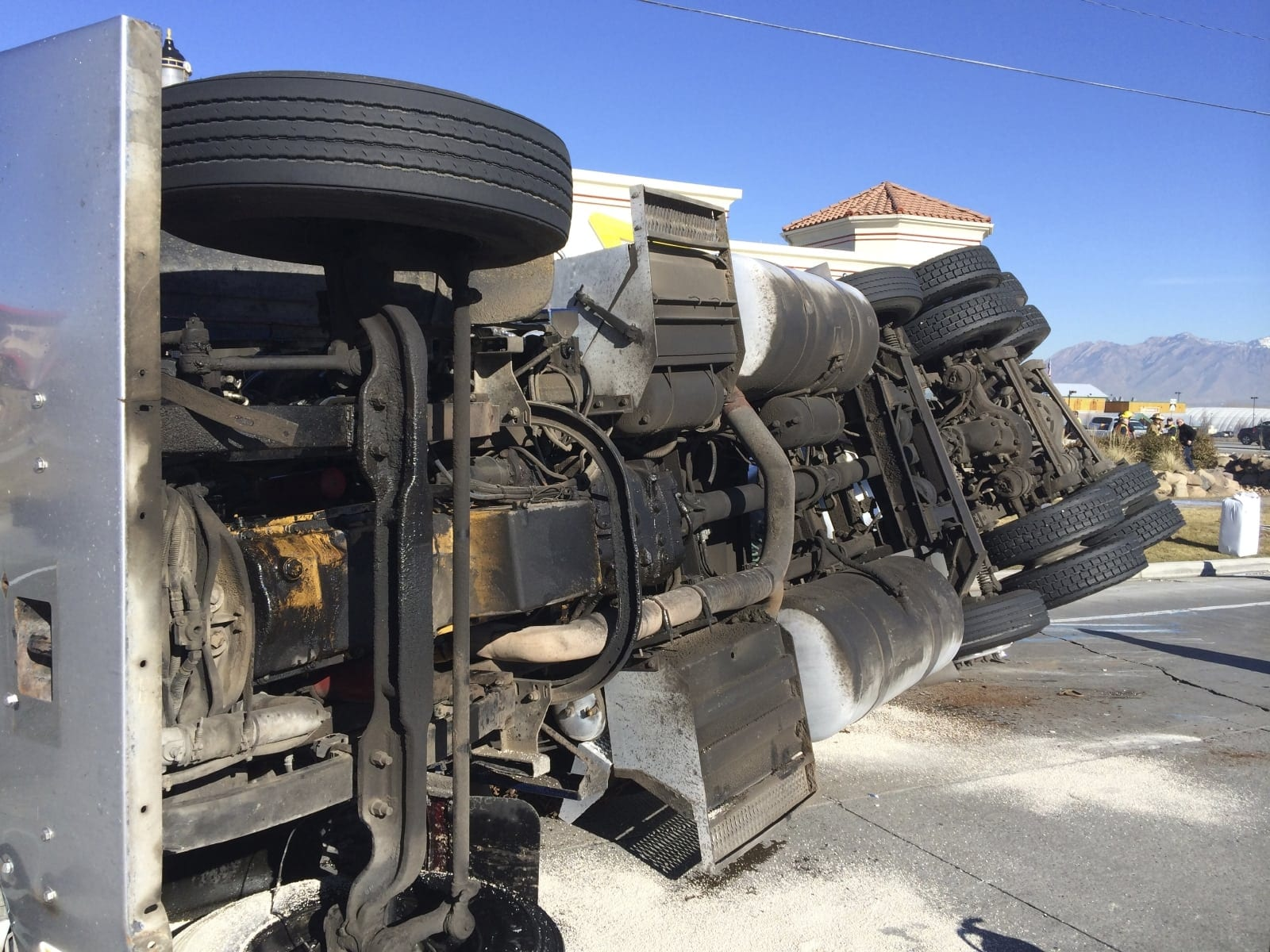 Large 18-wheeler Truck Turned On It's Side Stock Photo