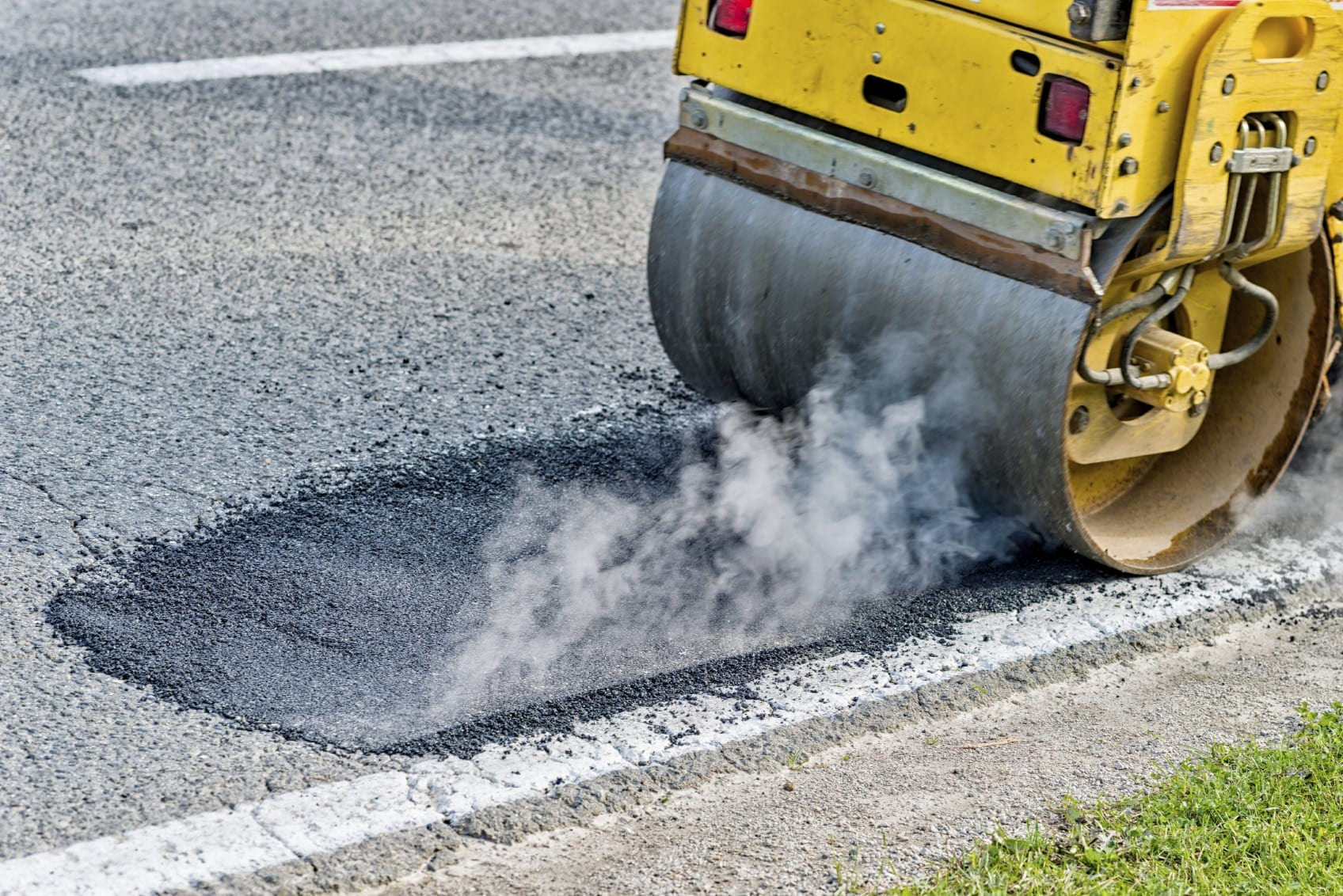 Road Workers Laying Blacktop Stock Photo