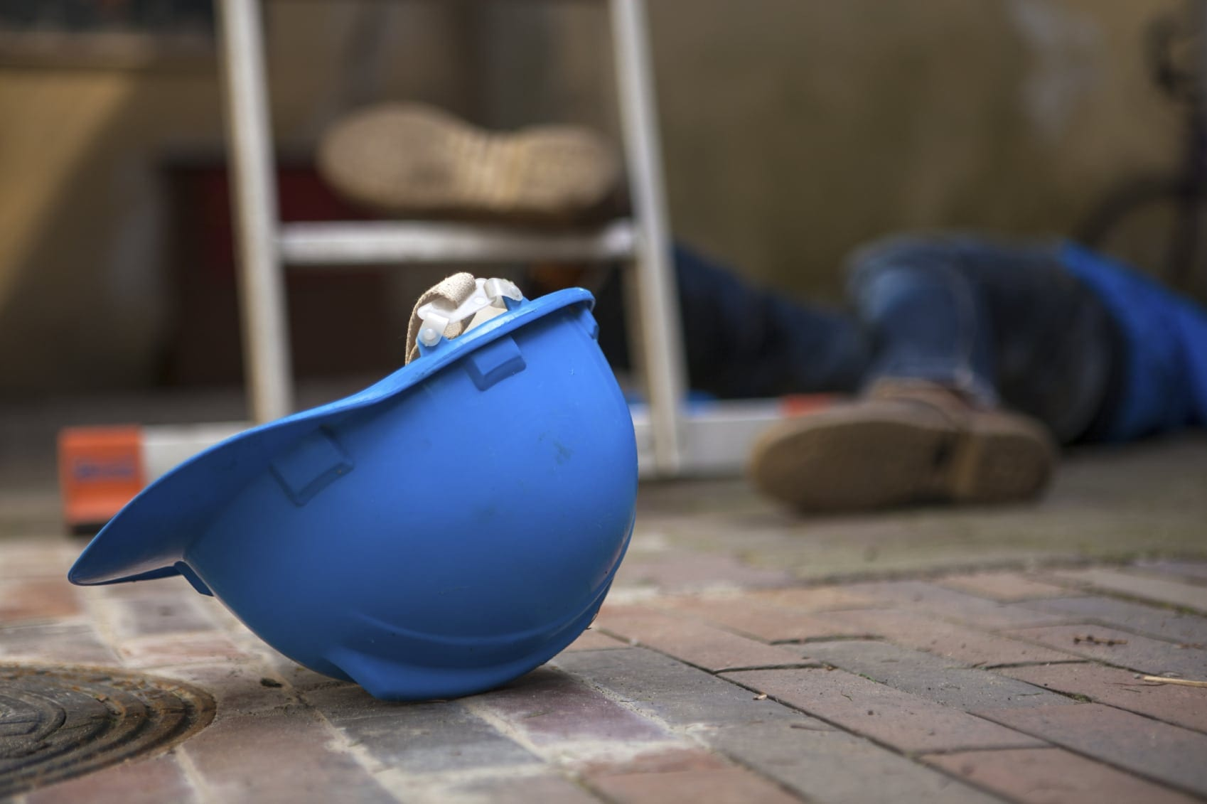 Injured Construction Worker Laying On Ground Stock Photo