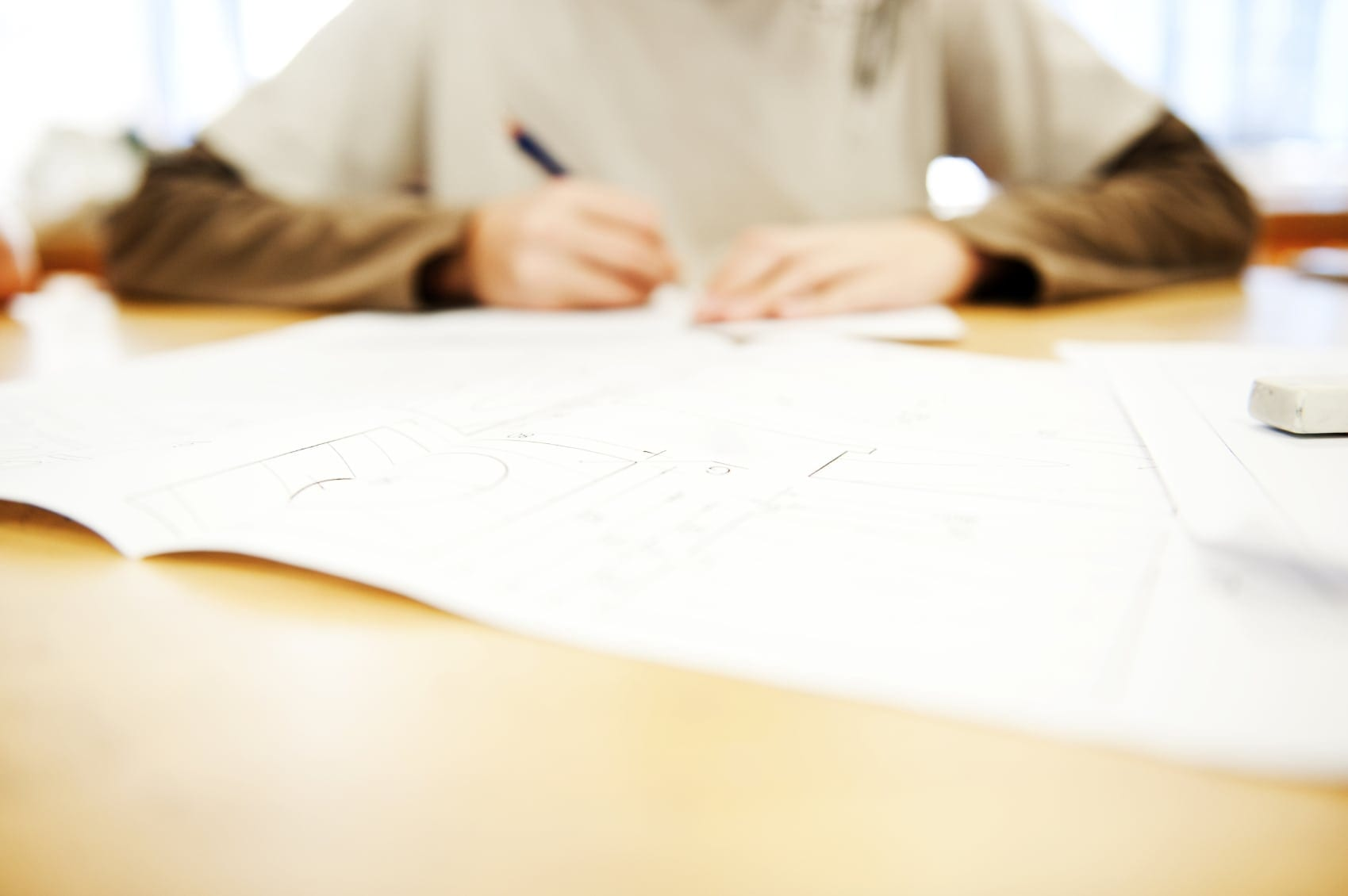 Young Man Writing At The Kitchen Table Stock Photo