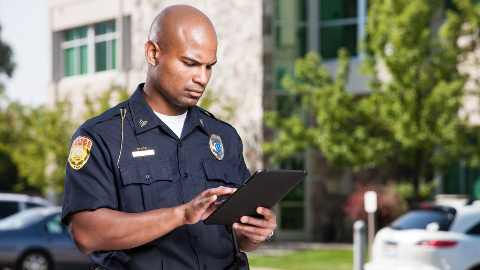 Police Officer Completing A Police Report Stock Photo