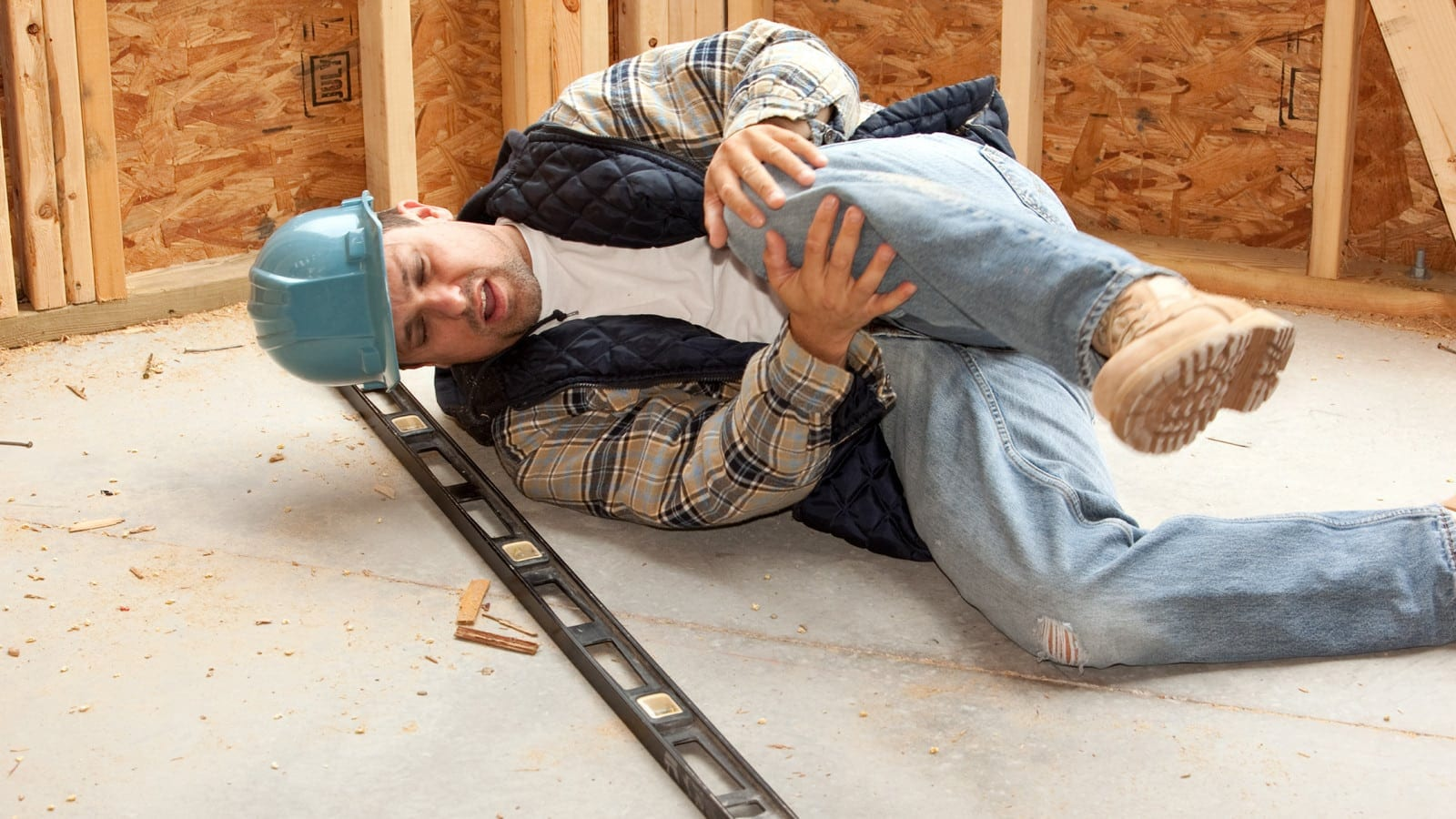 Construction Worker With A Knee Injury Stock Photo