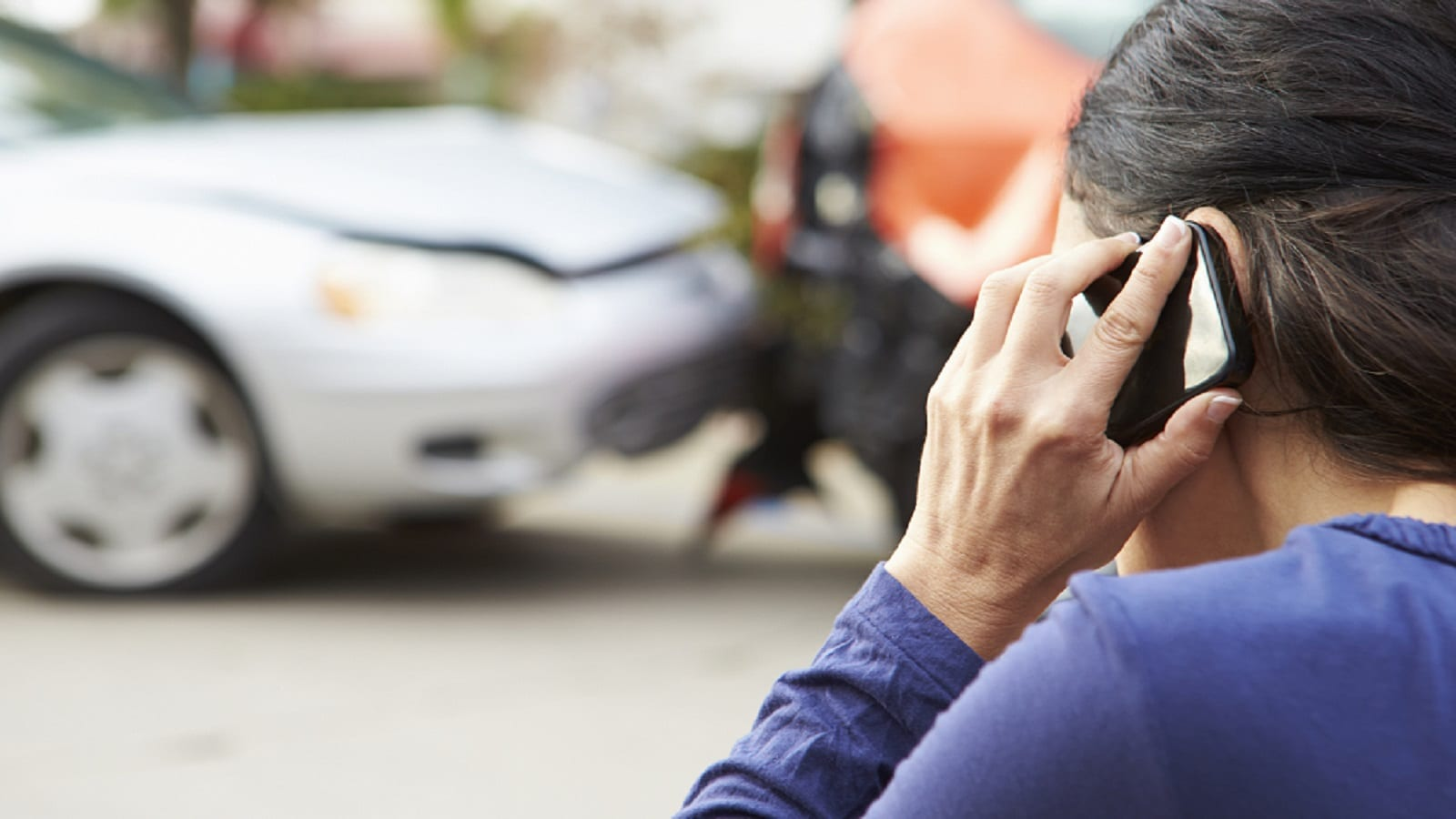 Female Driver Reporting A Car Accident Stock Photo