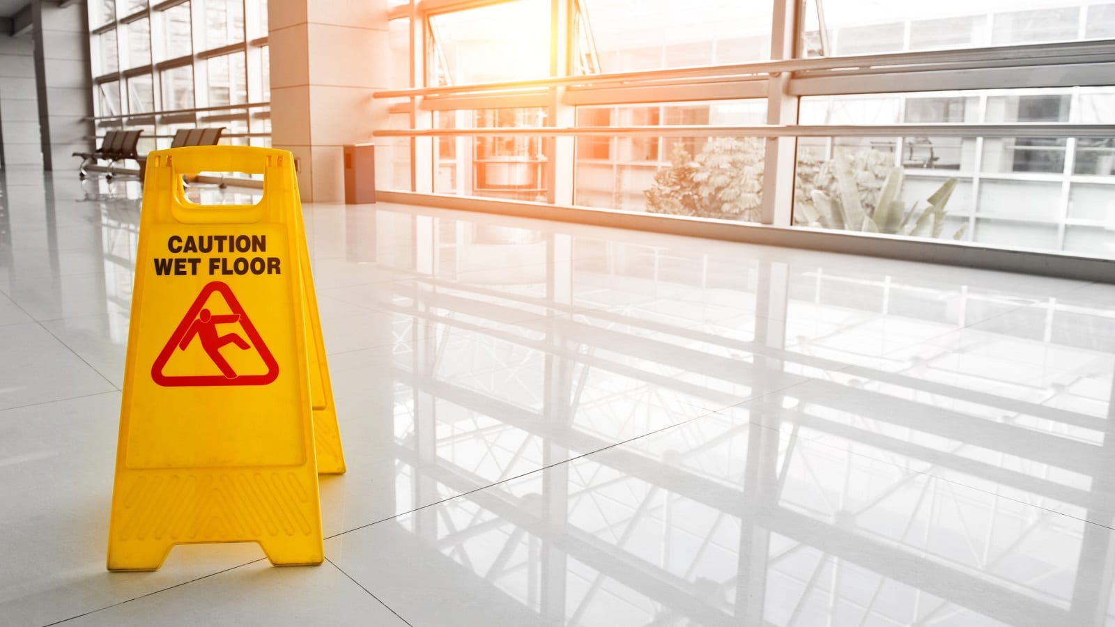 Yellow Caution Sign In Hallway Stock Photo