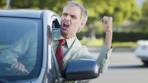 Angry Male Driver Shouting At Other Drivers Stock Photo