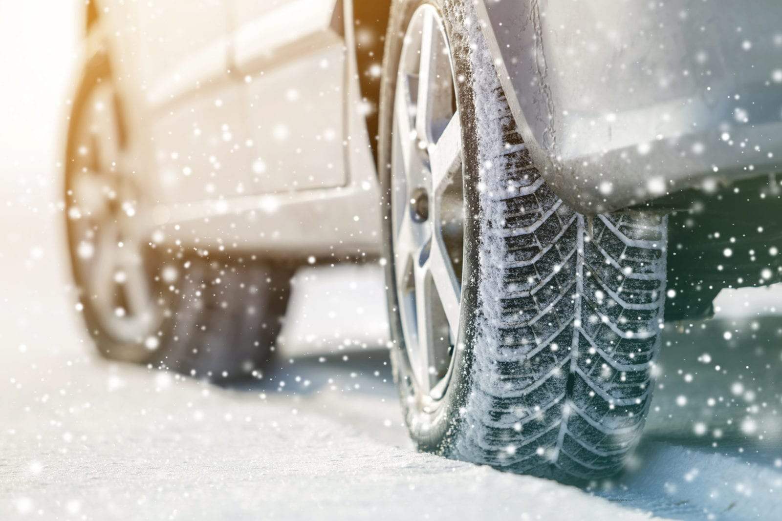 close-up-of-car-tires-in-winter-snow