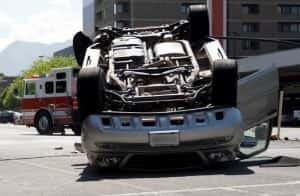 Rollover Auto Accident On A City Street Stock Photo