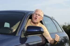 Elderly Driver With Road Rage Yelling Out The Window