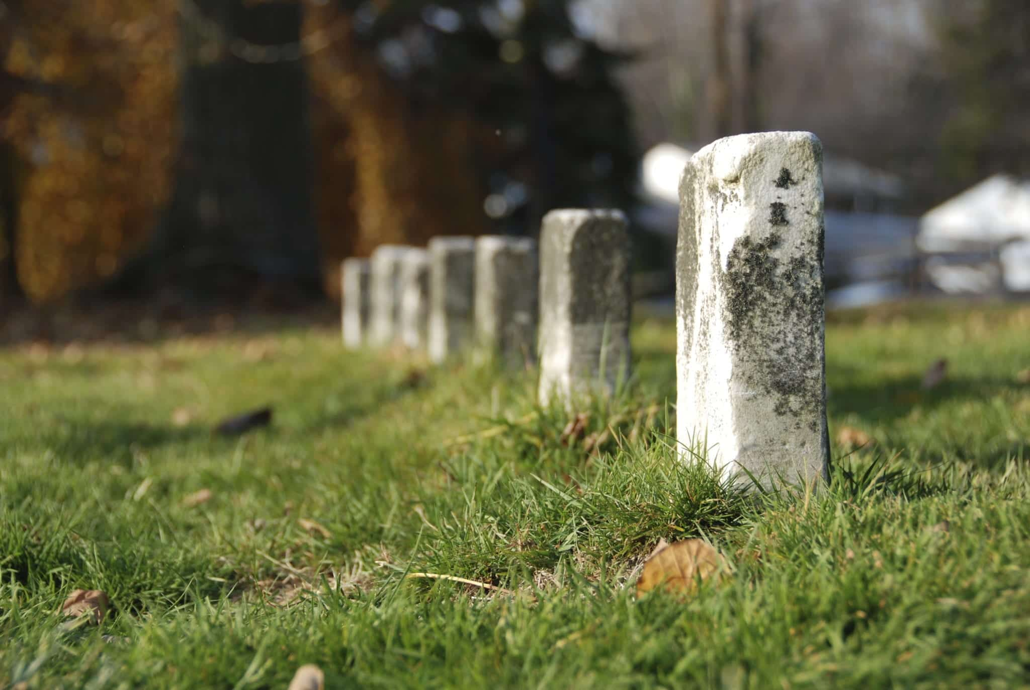 Close Up View Of Headstones Stock Photo