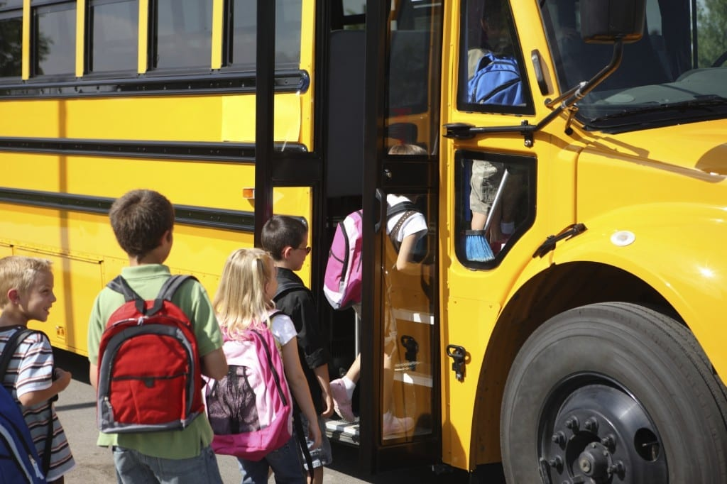 Children Getting Onto A School Bus Stock Photo