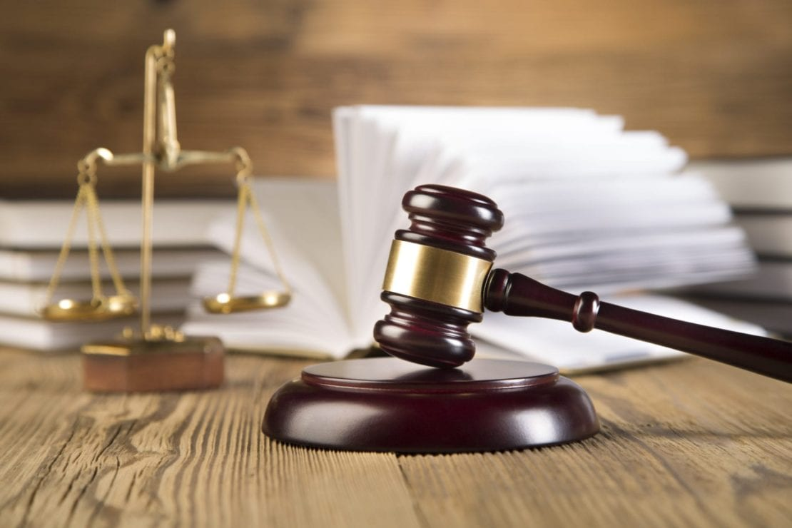 Scales Of Justice Laying Next To Judge's Gavel Stock Photo