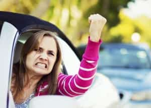 Female Driver Expressing Road Rage Stock Photo