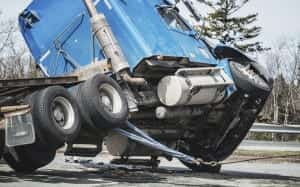 Blue 18-wheeler Truck Being Towed Away After Truck Accident