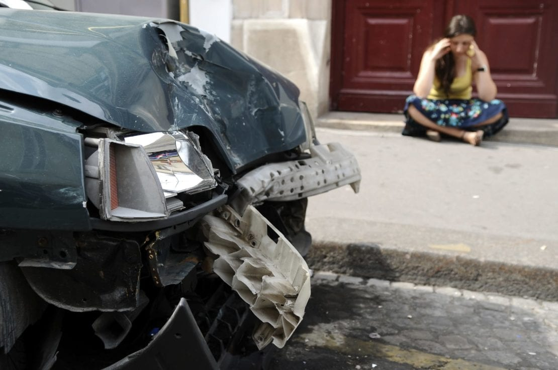 Woman In Distress After Car Accident Stock Photo