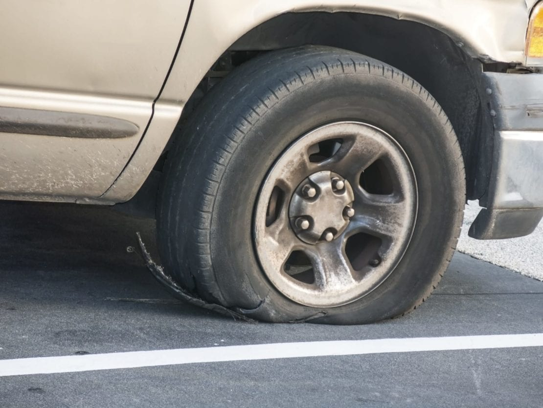 Pickup Truck With Flat Tire Stock Photo