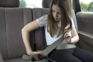 Young Girl Fastening Seat Belt Stock Photo