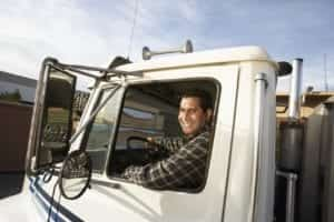 Male Truck Driver Smiling At The Camera Stock Photo