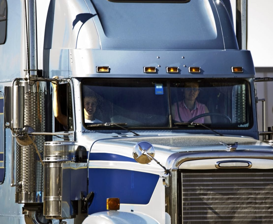 Woman Driving 18-wheeler Truck During The Day Stock Photo