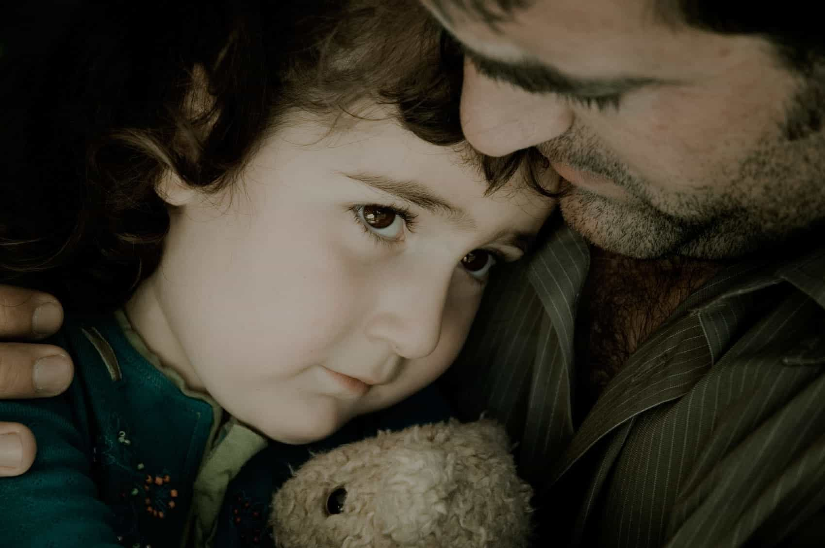 Father Consoling Young Daughter Stock Photo