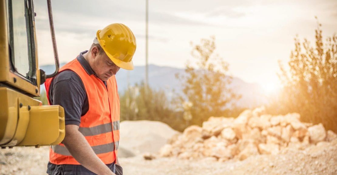 Construction Worker Working On A Job Site Stock Photo