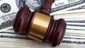 Judge's Gavel Laying On Top Of American Currency