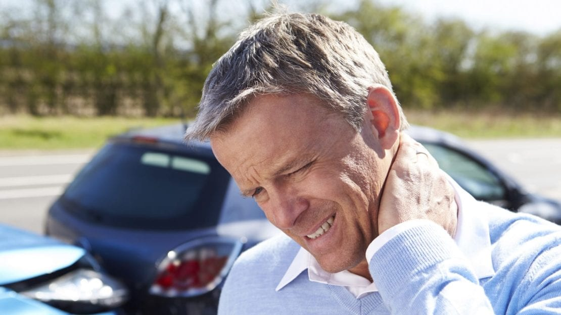 Older Man Experiencing Neck Pain After An Auto Accident Stock Photo